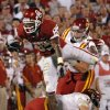 Oklahoma\'s Ryan Broyles (85) leaps over Iowa State\'s Zac Sandvig (3) during the first half of the college football game between the University of Oklahoma Sooners (OU) and the Iowa State Cyclones (ISU) at the Glaylord Family-Oklahoma Memorial Stadium on Saturday, Oct. 16, 2010, in Norman, Okla. Photo by Chris Landsberger, The Oklahoman