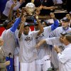 Oklahoma City\'s Kevin Durant holds the Western Conference trophy beside Nazr Mohammed, left, Kendrick Perkins, Serge Ibaka, Royal Ivey, Russell Westbrook, Cole Aldrich and Reggie Jackson after Game 6 of the Western Conference Finals between the Oklahoma City Thunder and the San Antonio Spurs in the NBA playoffs at the Chesapeake Energy Arena in Oklahoma City, Wednesday, June 6, 2012. Oklahoma City won 107-99. Photo by Bryan Terry, The Oklahoman