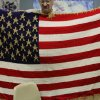 Eric Fowler, member of the Veteran\'s club, holds up a gold star quilted American flag as apart of the Afghan project at the James Crabtree Correction Center. Photo by Darryl Golden, The Oklahoman