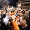 Oklahoma State\'s Jamie Blatnick (50) celebrates with fans following the Bedlam college football game between the Oklahoma State University Cowboys (OSU) and the University of Oklahoma Sooners (OU) at Boone Pickens Stadium in Stillwater, Okla., Saturday, Dec. 3, 2011. OSU won 44-10. Photo by Sarah Phipps, The Oklahoman