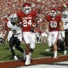 Photo -   Oklahoma running back Brennan Clay (24) runs into the end zone with a touchdown in front of Baylor defender Ahmad Dixon (6) in the first quarter of an NCAA college football game in Norman, Okla., Saturday, Nov. 10, 2012. (AP Photo/Sue Ogrocki)