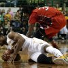 Photo - Baylor forward Rico Gathers, bottom, dives to the floor to grab a loose ball in front of Lamar forward Amos Wilson in the first half of an NCAA college basketball game on Wednesday, Dec. 12, 2012, in Waco, Texas. (AP Photo/Tony Gutierrez)
