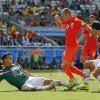 Photo - Mexico's Rafael Marquez, right, watches as teammate Hector Moreno slide tackles Netherlands' Arjen Robben during the World Cup round of 16 soccer match between the Netherlands and Mexico at the Arena Castelao in Fortaleza, Brazil, Sunday, June 29, 2014. (AP Photo/Eduardo Verdugo)