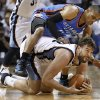 Memphis Grizzlies center Marc Gasol, bottom, of Spain, scrambles for the ball with Oklahoma City Thunder guard Russell Westbrook during the first half of Game 6 of a second-round NBA basketball playoff series on Friday, May 13, 2011, in Memphis, Tenn. (AP Photo/Wade Payne)