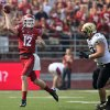 Photo -   Washington State quarterback Connor Halliday (12) throws while pursued by Colorado defensive end Will Pericak (83) and defensive tackle Nate Bonsu during the first quarter of an NCAA college football game Saturday, Sept. 22, 2012, at Martin Stadium in Pullman, Wash. (AP Photo/Dean Hare)