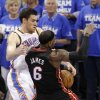 Oklahoma City\'s Nick Collison (4) fouls Miami\'s LeBron James (6) during Game 2 of the NBA Finals between the Oklahoma City Thunder and the Miami Heat at Chesapeake Energy Arena in Oklahoma City, Thursday, June 14, 2012. Photo by Chris Landsberger, The Oklahoman