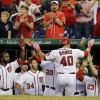 Photo - Washington Nationals' Wilson Ramos (40) celebrates his solo home run with teammates during the third inning of a baseball game against the New York Mets at Nationals Park, Friday, Aug. 30, 2013, in Washington. (AP Photo/Alex Brandon)