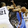 Oklahoma City\'s Russell Westbrook (0) loses the ball between San Antonio\'s Tim Duncan (21) and Tony Parker (9) during Game 5 of the Western Conference Finals between the Oklahoma City Thunder and the San Antonio Spurs in the NBA basketball playoffs at the AT&T Center in San Antonio, Monday, June 4, 2012. Photo by Nate Billings, The Oklahoman