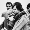 FILE - this 1988 file photo shows Addam Swapp hugging one of his sons during a court hearing in Salt Lake City. Swapp, the man who bombed a Mormon church building and sparked a 13-day standoff in 1988 that left a corrections officer dead at a polygamist compound, was released from prison on Tuesday, July 9, 2013, after more than 25 years behind bars. Swapp, 52, was accompanied by family members as he left Sanpete County Jail three months after members of the state board of pardons and parole approved his release, saying he had shown remorse for leading the standoff in Marion. (AP Photo/The Salt Lake Tribune, file)