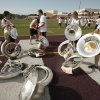 Sousaphone players pick up their instruments after taking a short break during Edmond Memorial High School\'s morning band practice in Edmond, OK, Tuesday, July 31, 2012, By Paul Hellstern, The Oklahoman