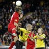 Photo -   Liverpool's Sebastian Coates from Uruguay, left, fights for the ball against Young Boys' Juhani Ojala from Finland, center, and Christoph Spycher, right, during the UEFA Europa League Group A soccer match between BSC Young Boys Bern and Liverpool FC at the Stade de Suisse in Bern, Switzerland, Thursday, September 20, 2012. (AP Photo/Peter Klaunzer/Keystone)