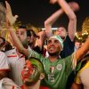 Photo - In this photo dated Thursday, June 26, 2014, Algerian soccer fans reacts as they watch a live broadcast of the Group H World Cup soccer match between Algeria and Russia in Algiers. Algeria advanced to the knockout rounds of the World Cup for the first time with a 1-1 tie against Russia. (AP Photo/Sidali Djarboub)