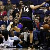 Oklahoma City Thunder\'s Kevin Durant, bottom left, collides with Phoenix Suns\' Luis Scola (14), of Argentina, as both go after a loose ball during the first half in an NBA basketball game, Sunday, Feb. 10, 2013, in Phoenix. (AP Photo/Ross D. Franklin)