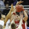 OU\'s Cade Davis is defended by OSU\'s Marshall Moses, left, and Keiton Page in the first half of the college basketball game during the men\'s Big 12 Championship tournament at the Sprint Center on Wednesday, March 10, 2010, in Kansas City, Mo. Photo by Bryan Terry, The Oklahoman
