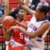 Carl Albert\'s Jazmine Anglin drives in the lane against Lauren Fonteno during first half action between Carl Albert Lady Titans and Millwood Lady Falcons in the 2012 Titan Classic Basketball Tournament at Carl Albert High School, Saturday, Jan. 21, 2012. The Lady Titans won 47-35. Photo by Jim Beckel, The Oklahoman