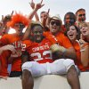 Oklahoma State\'s Dantrell Savage celebrates with the Cowboy fans after the 49-45 win over Texas Tech in the college football game between the Oklahoma State University Cowboys (OSU) and the Texas Tech University Red Raiders (TTU) at Boone Pickens Stadium on Saturday, Sept. 22, 2007, in Stillwater, Okla. By CHRIS LANDSBERGER, The Oklahoman