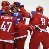 Photo - Russia forward Alexander Ovechkin taps defenseman Andrei Markov on the helmet after Markov scored a goal against Slovenia in the second period of a men's ice hockey game at the 2014 Winter Olympics, Thursday, Feb. 13, 2014, in Sochi, Russia. (AP Photo/Mark Humphrey)