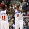 Philadelphia 76ers\' Thaddeus Young (21) celebrates with Jrue Holiday (11) after he scored against the Boston Celtics in the first half of an NBA basketball game, Tuesday, March 5, 2013, in Philadelphia. (AP Photo/H. Rumph Jr)