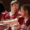 Sooner linemen Gabe Ikard (64) and Austin Woods (right) sign autographs during the Meet the Sooners event inside Gaylord Family/Oklahoma Memorial Stadium at the University of Oklahoma on Saturday, Aug. 4, 2012, in Norman, Okla. Photo by Steve Sisney, The Oklahoman