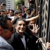 Egyptian popular television satirist Bassem Youssef, who has come to be known as Egypt\'s Jon Stewart, waves to is supporters as he enters Egypt\'s state prosecutors office to face accusations of insulting Islam and the country\'s Islamist leader in Cairo, Egypt, Sunday, March 31, 2013. Government opponents said the warrant against such a high profile figure, known for lampooning President Mohammed Morsi and the new Islamist political class, was an escalation in a campaign to intimidate critics. (AP Photo/Amr Nabil)