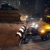 A plow drives across the Brooklyn Bridge during a winter storm in New York, late Thursday, Jan. 2, 2014. The storm is expected to bring snow, stiff winds and punishing cold into the Northeast. (AP Photo/Karly Domb Sadof)