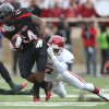 Texas Tech\'s Eric Stephens is taken down by Oklahoma\'s Corey Nelson during an NCAA college football game in Lubbock, Texas, Saturday, Oct. 6, 2012. (AP Photo/Lubbock Avalanche-Journal, Stephen Spillman) LOCAL TV OUT