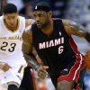 Photo - Miami Heat forward LeBron James (6) drives past New Orleans Pelicans forward Anthony Davis (23) during the first half of an NBA basketball game, Saturday, March 22, 2014, in New Orleans. (AP Photo/Jonathan Bachman)