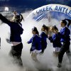 Deer Creek cheer and pom members leave the field after the team introductions before a high school football game against Guthrie at Deer Creek in Oklahoma City, Friday, October 25, 2013. Photo by Bryan Terry, The Oklahoman