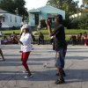 Photo -   Gary Ind., residents dance to recorded music outside Jackson's boyhood home during celebrations marking what would have been Jackson's 54th birthday Wednesday, Aug. 29, 2012, in Gary. (AP Photo/Charles Rex Arbogast)