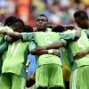 Photo - Nigeria's Emmanuel Emenike, center, looks up as his team form a huddle before the start of the second half during the World Cup round of 16 soccer match between France and Nigeria at the Estadio Nacional in Brasilia, Brazil, Monday, June 30, 2014. (AP Photo/Martin Meissner)