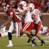 Oklahoma\'s Adron Tennell (80) has a pass broken up by Nebraska\'s Anthony West (5) and Blake Lawrence (40) during the first half of the college football game between the University of Oklahoma Sooners (OU) and the University of Nebraska Huskers (NU) at the Gaylord Family-Oklahoma Memorial Stadium, on Saturday, Nov. 1, 2008, in Norman, Okla. BY NATE BILLINGS, THE OKLAHOMAN