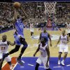 Oklahoma City Thunder\'s Kevin Durant (35) goes up for a dunk between Philadelphia 76ers\' Jason Richardson (23) and Jrue Holiday (11) during the first half of an NBA basketball game, Saturday, Nov. 24, 2012, in Philadelphia. (AP Photo/Matt Slocum) ORG XMIT: PXC108
