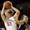 Oklahoma\'s Joanna McFarland (53) grabs a rebound next to Kansas State\'s Brianna Craig (20) during an NCAA women\'s college basketball game between the University of Oklahoma (OU) and Kansas State at Lloyd Noble Center in Norman, Okla., Wednesday, Feb. 20, 2013. Photo by Nate Billings, The Oklahoman