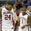 Oklahoma\'s Romero Osby (24) and Sam Grooms (1) walk off the court after losing in the Phillips 66 Big 12 Men\'s basketball championship tournament game between the University of Oklahoma and Iowa State at the Sprint Center in Kansas City, Thursday, March 14, 2013. Photo by Sarah Phipps, The Oklahoman