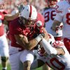 Stanford running back Kelsey Young rushes for a touchdown against Wisconsin defensive back Devin Smith during the first half of the Rose Bowl NCAA college football game, Tuesday, Jan. 1, 2013, in Pasadena, Calif. (AP Photo/Mark J. Terrill)
