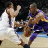 Thabo Sefolosha, left, tries to knock the ball away from Los Angeles\' Kobe Bryant during OKC\'s 91-75 win Friday. PHOTO BY NATE BILLINGS, THE OKLAHOMAN