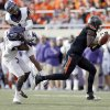 Oklahoma State\'s Blake Jackson (18) drops a pass as TCU\'s Chris Hackett (1) and Elisha Olabode (6) collide into each other during a college football game between Oklahoma State University (OSU) and Texas Christian University (TCU) at Boone Pickens Stadium in Stillwater, Okla., Saturday, Oct. 27, 2012. Photo by Sarah Phipps, The Oklahoman