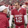 Sooner head coach Bob Stoops congratulates quarterback Landry Jones after a college football game in which the University of Oklahoma Sooners (OU) defeated the Iowa State University Cyclones (ISU) 26-6 at Gaylord Family-Oklahoma Memorial Stadium in Norman, Okla., Saturday, Nov. 26, 2011. Photo by Steve Sinsey, The Oklahoman