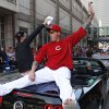 Photo - Cincinnati Reds starting pitcher Mat Latos rides on the back of a car during the annual opening day parade, Monday, March 31, 2014, in Cincinnati. The Cincinnati Reds play the St. Louis Cardinals. (AP Photo/David Kohl)