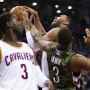 Toronto Raptors\' Kyle Lowry, right, fouls Cleveland Cavaliers\' Wayne Ellington, center, as Dion Waiters watches during the first half of an NBA basketball game, Saturday, Jan. 26, 2013, in Toronto. (AP Photo/The Canadian Press, Chris Young)