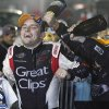 James Buescher is doused while celebrating after winning the NASCAR Nationwide Truck Series championship on Friday, Nov. 16 2012, at Homestead-Miami Speedway in Homestead, Fla. (AP Photo/Terry Renna)