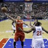 Houston Rockets\' Jeremy Lin, left, goes up for a shot against Philadelphia 76ers\' Thaddeus Young in the first half of an NBA basketball game, Saturday, Jan. 12, 2013, in Philadelphia. (AP Photo/Matt Slocum)