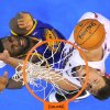 Los Angeles Clippers forward Blake Griffin, right, shoots against Golden State Warriors center Festus Ezeli, of Nigeria, during the first half of their NBA basketball game, Saturday, Jan. 5, 2013, in Los Angeles. (AP Photo/Mark J. Terrill)