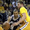 San Antonio Spur\'s Tony Parker, left, of France, drives the ball past Golden State Warriors\' David Lee during the first half of an NBA basketball game, Friday, Feb. 22, 2013, in Oakland, Calif. (AP Photo/Ben Margot)
