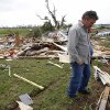 Photo -  Jimmy Talley looks over the destroyed home of his brother, David, and sister-in-law, Katherine, on Tuesday, April 26, 2011, in Vilonia, Ark. Both David and Katherine Talley were killed when a tornado hit Vilonia. The couple had taken shelter in a metal utility building, but they died when the building was blown across a pond. (AP Photo/Mark Humphrey) ORG XMIT: ARMH106