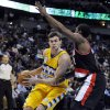 Photo - Denver Nuggets forward Danilo Gallinari (8) from Italy drives around Portland Trail Blazers guard Wesley Matthews (2) during the third quarter of an NBA basketball game, Tuesday, Jan. 15, 2013, in Denver. (AP Photo/Jack Dempsey)