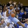 Photo - North Carolina's Xylina McDaniel and Duke's Elizabeth Williams, left, struggle for possession of a rebound during the first half of an NCAA college basketball game in Durham, N.C., Monday, Feb. 10, 2014. (AP Photo/Gerry Broome)