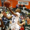Putnam City\'s Ronnie Boyce goes past Edmond Santa Fe\'s Phoenix Bills during a high school basketball game at Putnam City in Oklahoma City, Tuesday, Feb. 7, 2012. Photo by Bryan Terry, The Oklahoman