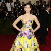 """Emmy Rossum attends The Metropolitan Museum of Art\'s Costume Institute benefit gala celebrating """"Charles James: Beyond Fashion"""" on Monday, May 5, 2014, in New York. (Photo by Charles Sykes/Invision/AP)"""