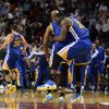 Golden State Warriors\' Draymond Green (23) celebrates with teammate Jarrett Jack against the Miami Heat during an NBA basketball game on Wednesday, Dec. 12, 2012, in Miami. The Warriors won 97-95. (AP Photo/Rhona Wise) ORG XMIT: AAA108